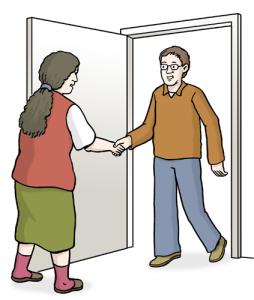 Bild: Frau lässt Besucher herein